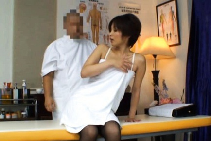 Asian housewife has massage appointment